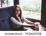 woman wearing glasses is...   Shutterstock . vector #742665538