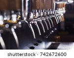 beer taps in a pub | Shutterstock . vector #742672600