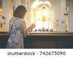christian woman is holding... | Shutterstock . vector #742675090