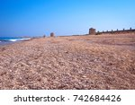 old mills on the beach | Shutterstock . vector #742684426