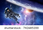 astronaut on space mission | Shutterstock . vector #742685200