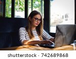 woman sitting at laptop working ...   Shutterstock . vector #742689868
