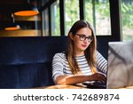 woman sitting at laptop working ...   Shutterstock . vector #742689874