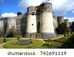 Small photo of The Château d'Angers is a castle in the city of Angers (Loire Valley), in the département of Maine-et-Loire. Founded in the 9th century by the Counts of Anjou