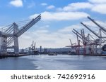 cranes in the port in seattle ... | Shutterstock . vector #742692916