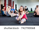 happy woman stretching while... | Shutterstock . vector #742700068