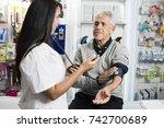female chemist checking blood... | Shutterstock . vector #742700689