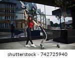 brunette girl in modern urban... | Shutterstock . vector #742725940