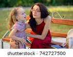 happy family in the city park... | Shutterstock . vector #742727500