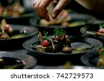 chef adds finish touches to... | Shutterstock . vector #742729573