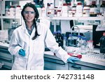portrait of a smiling chemist... | Shutterstock . vector #742731148