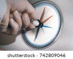 hand turning an orientation... | Shutterstock . vector #742809046