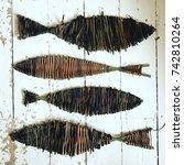 Four Willow Fish Sculptures