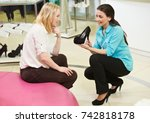 man and assistant at shoe... | Shutterstock . vector #742818178