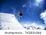 Expert freestyle skier jumping