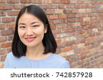 Asian Woman And Success Concep...