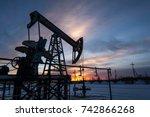 pump jack at sunset sky...