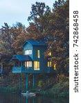 scandinavian cottage in autumn... | Shutterstock . vector #742868458