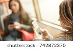 young girl uses a mobile phone... | Shutterstock . vector #742872370