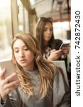 young girl uses a mobile phone...   Shutterstock . vector #742872430