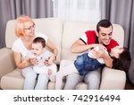 mother  father and two... | Shutterstock . vector #742916494