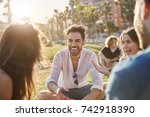 young man sitting outside with...   Shutterstock . vector #742918390