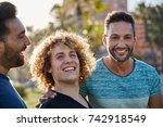 handsome man standing outside... | Shutterstock . vector #742918549