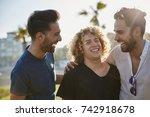 three male friends standing... | Shutterstock . vector #742918678