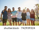 happy group of friends standing ...   Shutterstock . vector #742939324