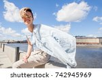 young smiling girl is sitting... | Shutterstock . vector #742945969