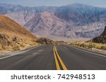 the road through death valley... | Shutterstock . vector #742948513