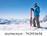 skier holding ski and looking... | Shutterstock . vector #742953658