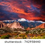 Pikes Peak Soaring over the Garden of the Gods with Dramatic Sky - stock photo