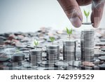 male hand putting coins with...   Shutterstock . vector #742959529