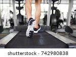 man running on treadmill at the ... | Shutterstock . vector #742980838
