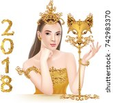 beautiful girl with golden mask ... | Shutterstock .eps vector #742983370