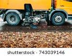 in motion orange street sweeper ... | Shutterstock . vector #743039146