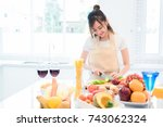 woman cooking and slicing... | Shutterstock . vector #743062324