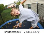 smiling boy jumping on a... | Shutterstock . vector #743116279