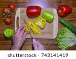 cutting colorfull peppers on a... | Shutterstock . vector #743141419