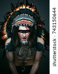 Small photo of american Indian men in a headdress of feathers