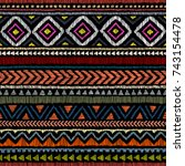 Embroidered ethnic seamless pattern. Aztec and tribal motifs. Striped ornament hand drawn. Print in the bohemian style. Vector illustration. | Shutterstock vector #743154478
