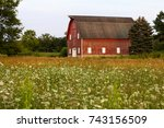 wildflowers and barn at leroy... | Shutterstock . vector #743156509