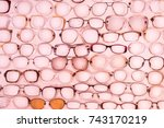 a lot of glasses on a pink... | Shutterstock . vector #743170219