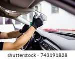 a man cleaning car interior ... | Shutterstock . vector #743191828