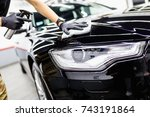 a man cleaning car with... | Shutterstock . vector #743191864