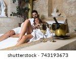 beautiful young couple enjoying ... | Shutterstock . vector #743193673