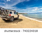 off road car on the sea coast | Shutterstock . vector #743224318