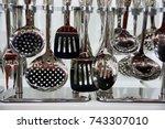 kitchen utensils hang on the