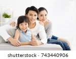 happy asian family on sofa in... | Shutterstock . vector #743440906